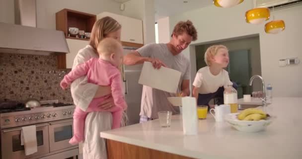 Family Standing and Having Breakfast in Kitchen