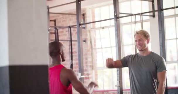 Mans giving high five after crossfit workout