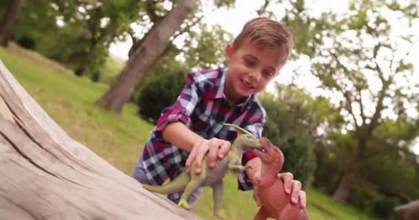 Little boy playing with dinosaur toys