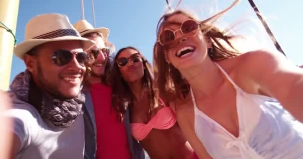 group of friends taking selfie on summer day