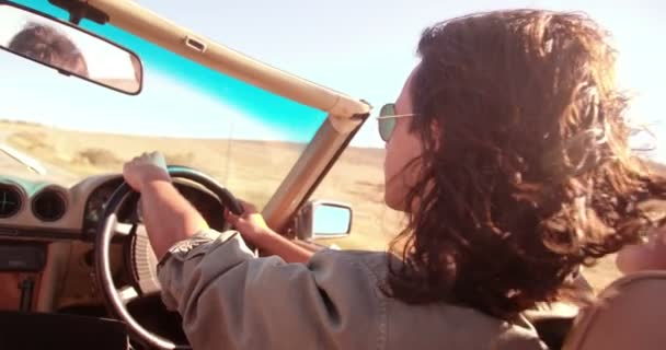 man driving a convertible and enjoys road trip