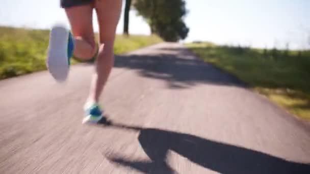 Runner running on road