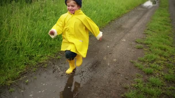Young Boy Running Through Puddle
