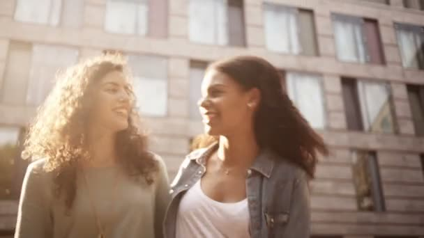 Friends walking and talking in city