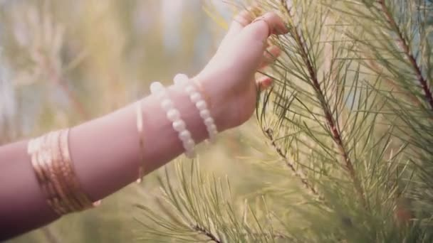 Boho girl feeling pine needles