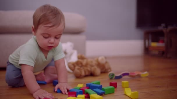 Boy playing with colorful building block