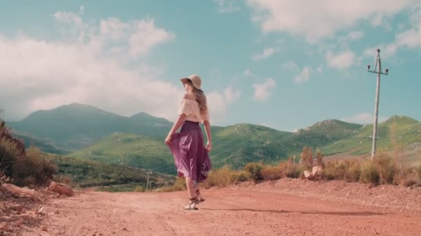Boho girl walking on country road