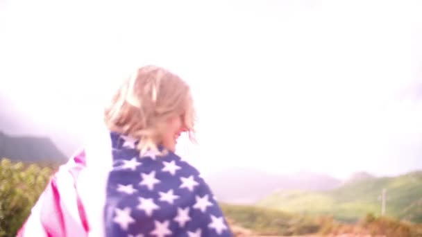 Girl with an American flag in countryside