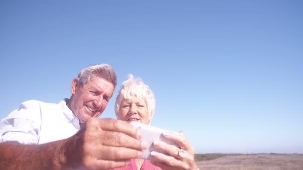 Elderly couple taking a selfie on phone