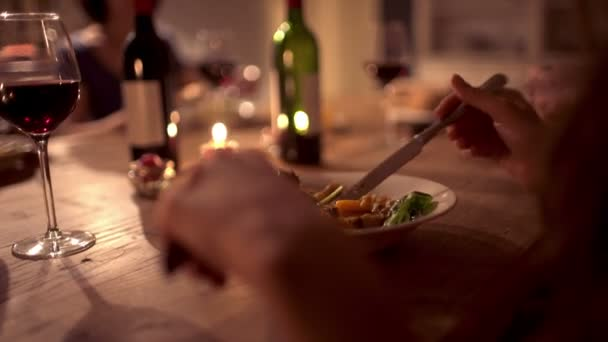 Woman enjoying food at a dinner party