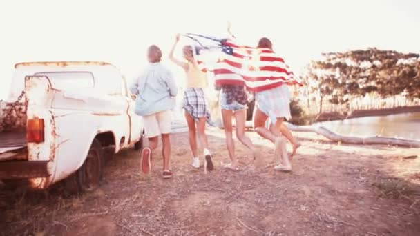 Teens running with an American flag