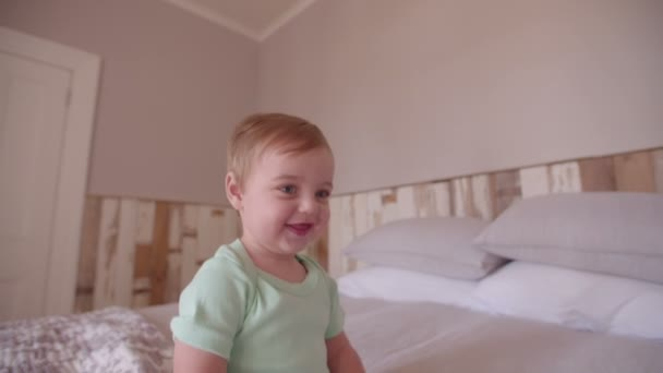 Baby boy crawling and exploring the bed