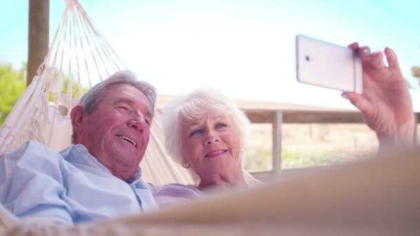 Senior couple taking a selfie with smartphone