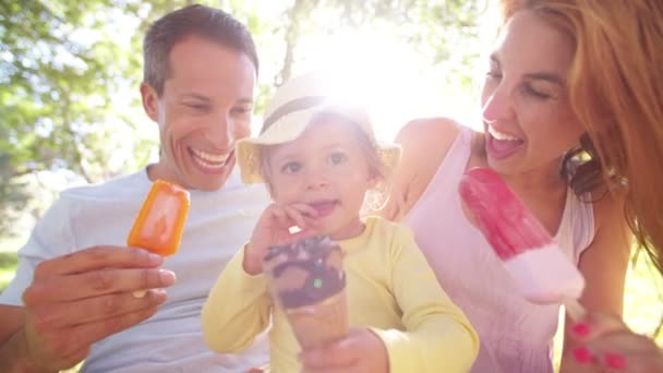 Parents with daughter eating ice creams