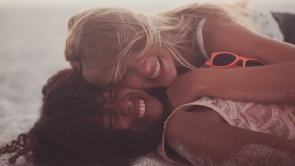 Girl and her friend lying down on the beach