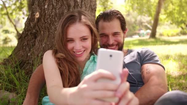 Couple taking selfie in a park