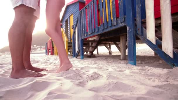 Couples legs in the sand on beach