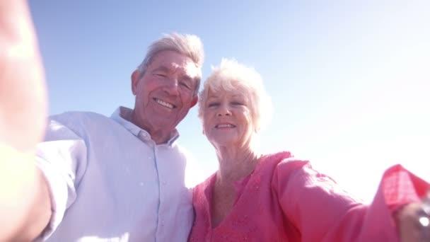 Retired couple taking a self portrait