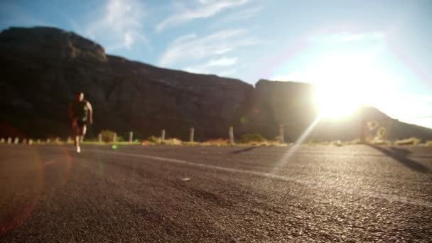 Afro runner sprinting past camera