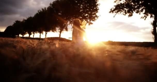 Woman Running in Wheat Field