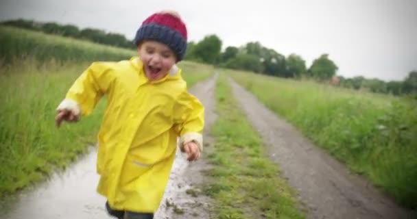 boy running outside after rain