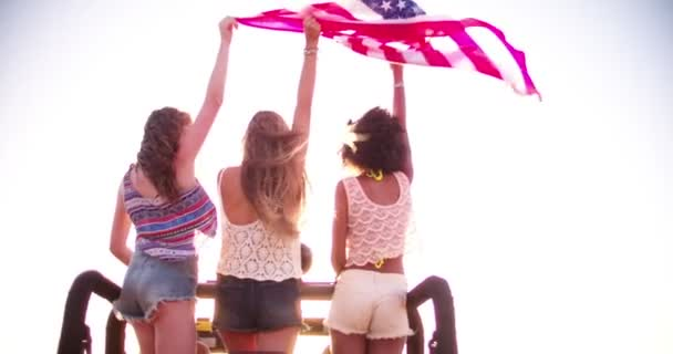 girls happily flying an American flag