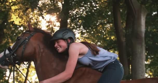 Girl leaning lovingly on her horse