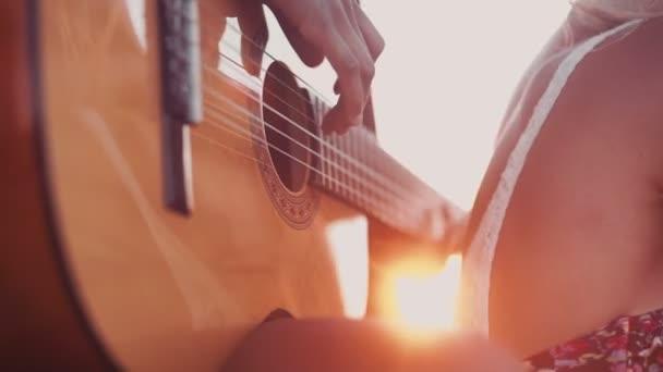 Afro girl playing guitar