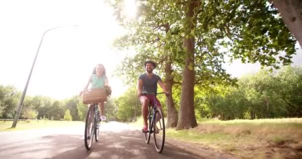 Young couple cycling happily together