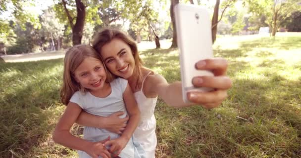 Little girl and mom taking a selfie