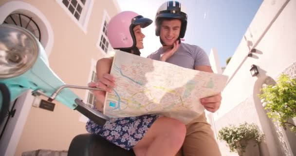 Couple using map while on road trip