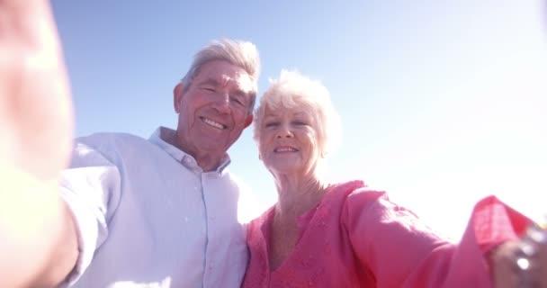 Elderly retired couple taking a self-portrait