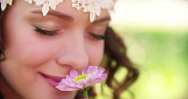 Girl in boho style smelling a fresh flower