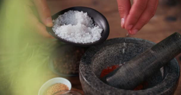 Salt added into a mortar and pestle