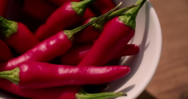 vibrant red chilli peppers in a bowl