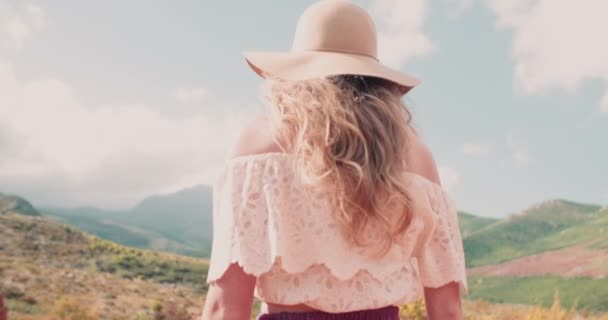Girl in boho fashion in a natural landscape