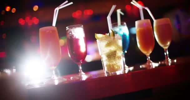 Cocktails on bar counter in night club