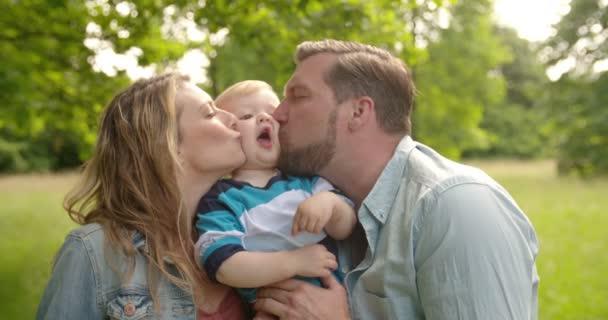 Mom and Dad Kissing Boy
