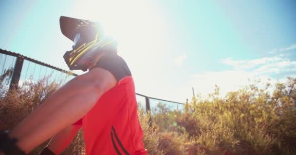 Mountain biker pausing on a rough trail