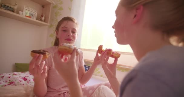 Teen girls eating a donuts