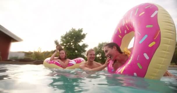 Teenage Friends in swimming pool