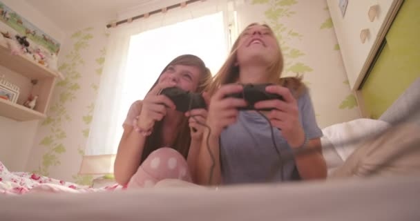 Girls in pyjamas playing computer games