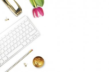Office desk and woman objects on white table. Flat lay. Tulip , gold stapler, pencil. Table view. Still life of fashion