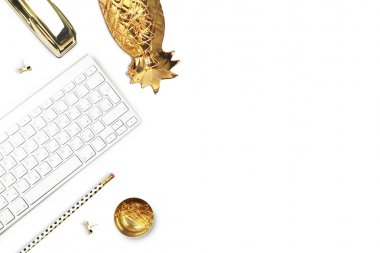 Office desk and woman objects on white table. Flat lay. Gold pineapple, gold stapler, pencil. Still life of fashion