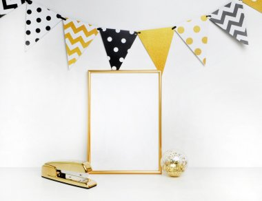Gold frame and stapler.