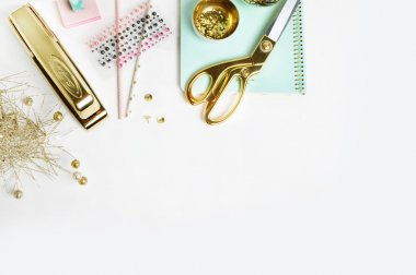 Flat lay. White Desktop. Header website or Hero website, Mock up product view table gold accessories. stationery supplies. glamour style. Gold stapler
