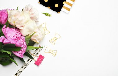 White background, view table, peonies with stationery, gold clips, pencil, gold polka pattern, and pattern gold stripe