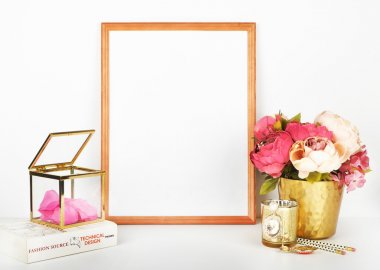 Gold frame mock-up, and white wall with gold vase, and peonies. Place work