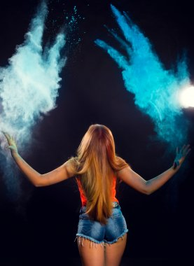Girl with colored powder exploding around her and into the background. stock vector