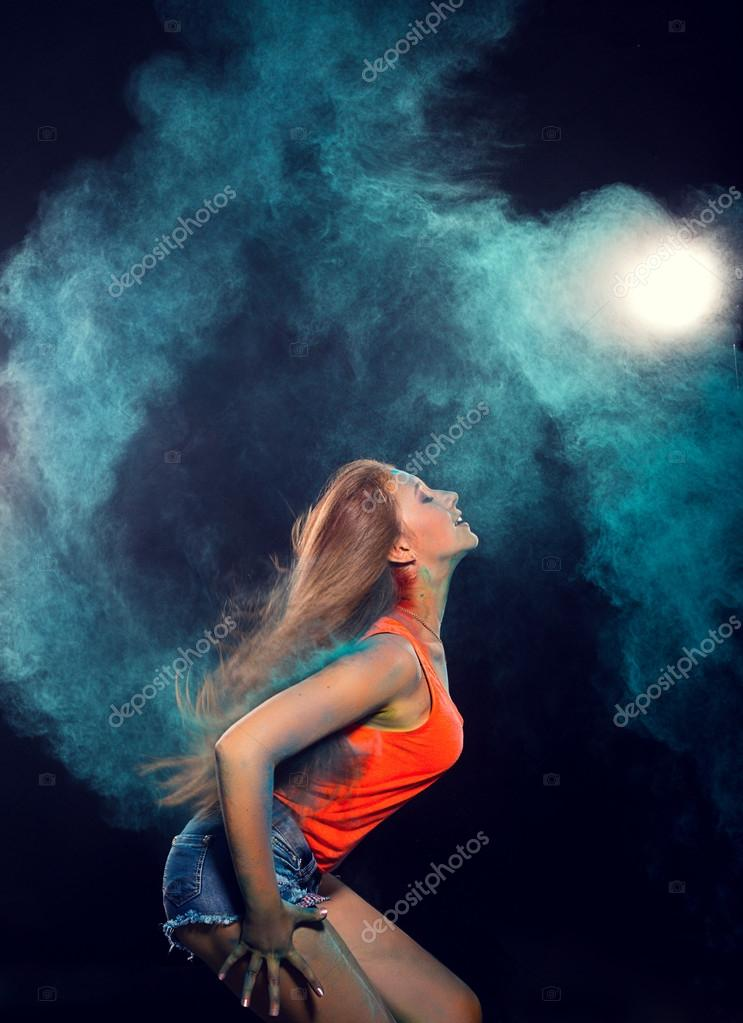 Girl with colored powder trailing behind her hair that she is flinging up stock vector